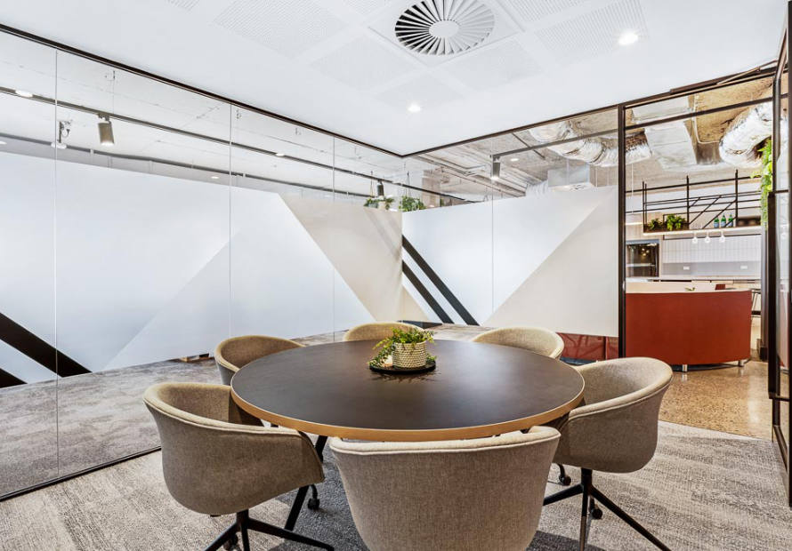round boardroom table by infinity commercial furniture